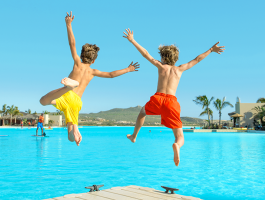 Kids jumping off dock at Crystal Lagoons®